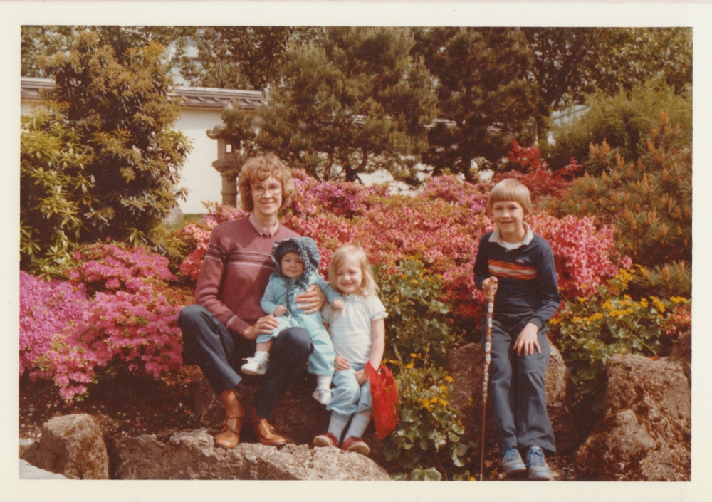 My Mom with me, Heid, and David in a garden in Stuttgart- David has his cane with the plaques on it